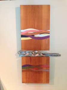 This painted pine and steel wall sculpture was created in 1971.
